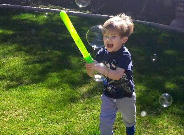 Little boy playing with a toy lightsaber